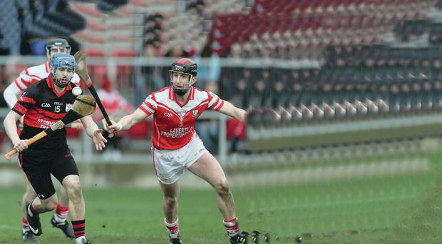 Battle for possession: Mount Leinster's Eoin Doyle in action against Loughgiel's Neilly McGarry