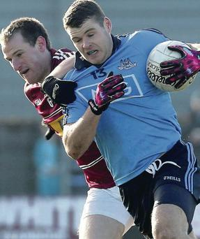 Tussle: John Gilligan with Dublin's Kevin McManamon
