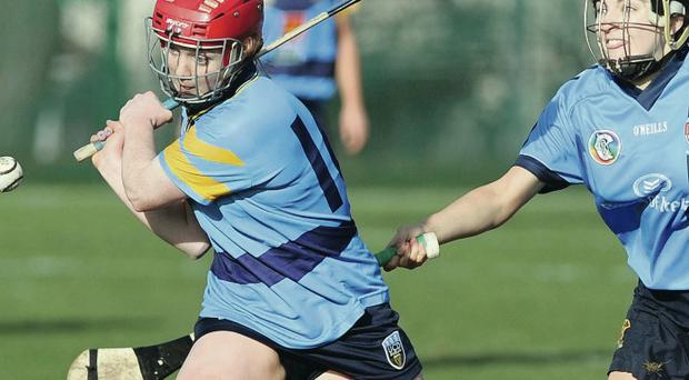 Up close: UUJ's Niamh Mallon (right) challenges UCD's Sinead Kennedy in yesterday's Ashbourne Shield final at The Dub