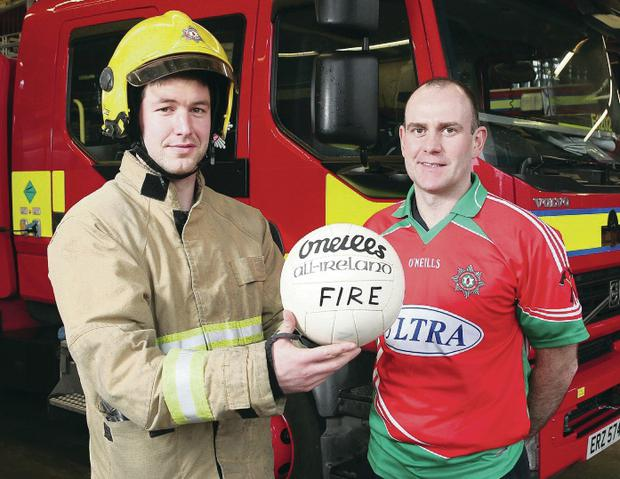 Ready for action: Fire & Rescue Service Crew Commander Ronan O'Reilly (right) and firefighter Peter Turley
