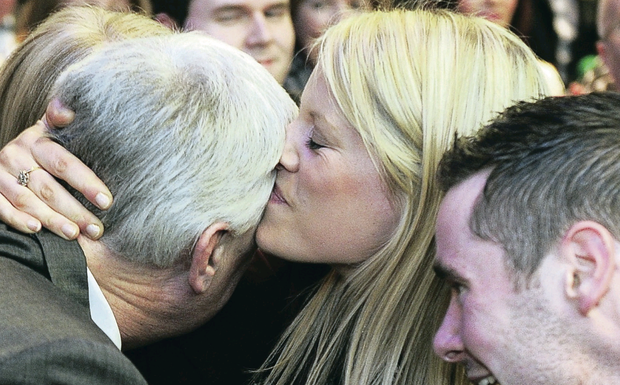Sealed with a kiss: Aogan O'Farrell is congratulated by wife Francis and son Aogan Og