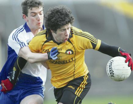 Tight affair: Sean Cavanagh of Ulster wrestles with Joss Moore of Connacht at Tuam Stadium yesterday