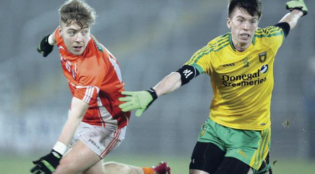 Donegal's Ciaran Brennan (right) battles with Armagh's Paul McGeown last night at Kingspan Breffni Park