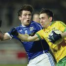 Battle stations: Cavan's Enda Flanagan (left) clashes with Donegal's Martin O'Reilly at the Athletic Grounds last night