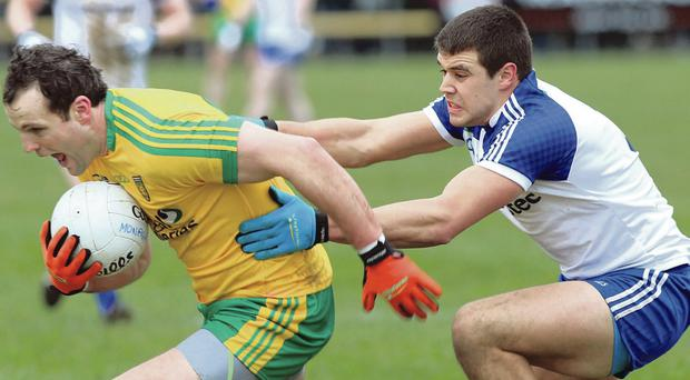 Getting shirty: Monaghan's Drew Wylie attempts to slow Michael Murphy of Donegal when the two sides met in March