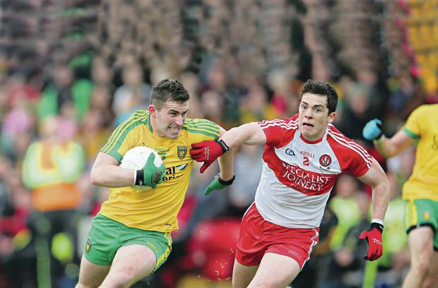 Holding on: Derry's Dermot McBride clings to Patrick McBrearty