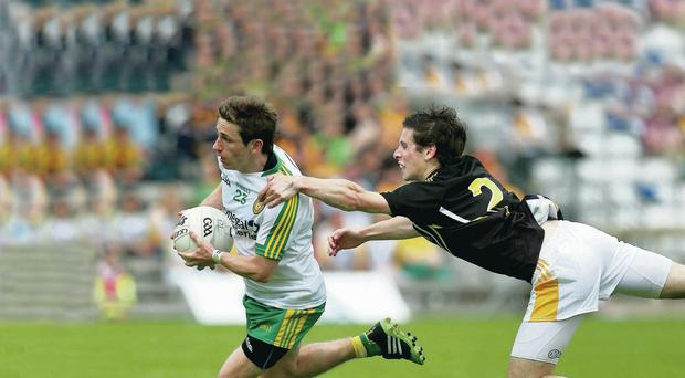 Stretched to the limit: Darragh O'Connor of Donegal is pursued by Kevin Boyle
