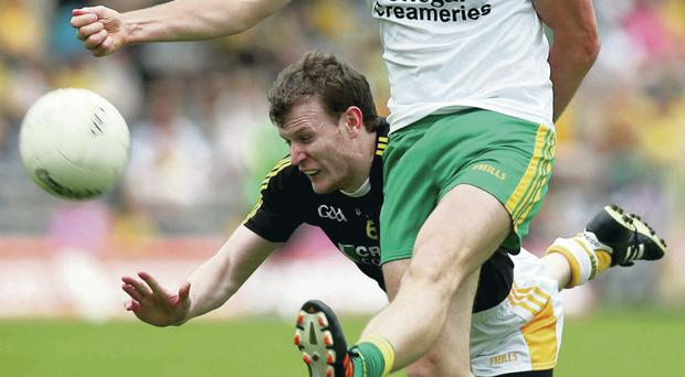 Getting his kicks: Justin Crozier closes down Donegal's Colm McFadden in Clones