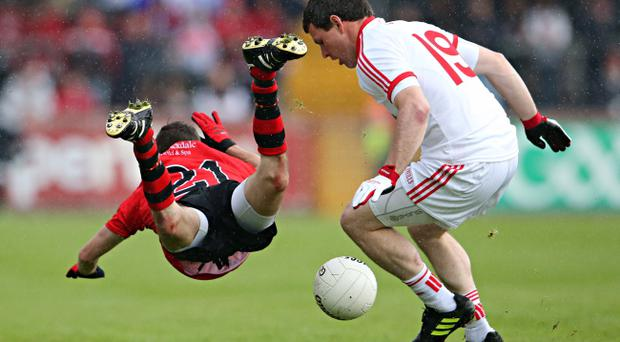Utility man: Tyrone ace Conor Gormley may be the answer to some tricky questions boss Mickey Harte will face over the coming week