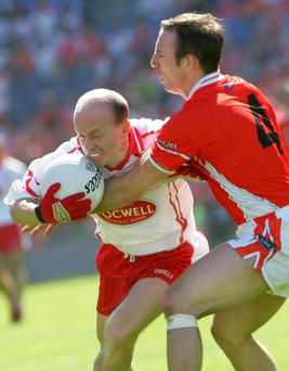Tyrone's Peter Canavan takes on Armagh's Enda McNulty