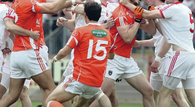 Up in arms: Armagh and Tyrone players get shirty at Healy Park