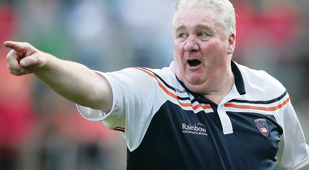 To the point: Armagh manager Paul Grimley insists he is going nowhere after rumours surfaced that he may hand over the reins