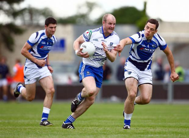 Fit to go: Determination etched on the face of Monaghan's Dick Clerkin (centre)