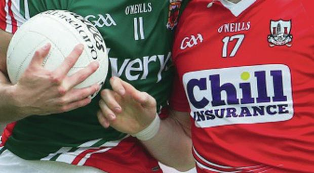 Closed down: Mayo's Aidan O'Shea with Damien Cahalane