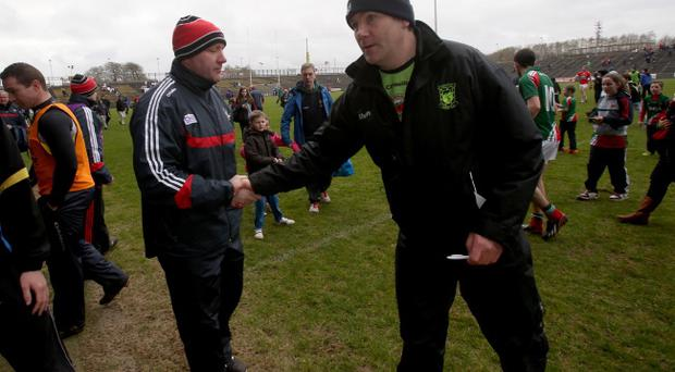War of words: Rival managers Brian Cuthbert (left) of Cork and Mayo's James Horan shake hands earlier in the year, but there was no repeat at Croke Park on Sunday