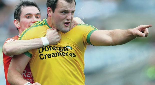 Key role: Donegal's Michael Murphy, pictured being held back by Andy Mallon, delivered for his side