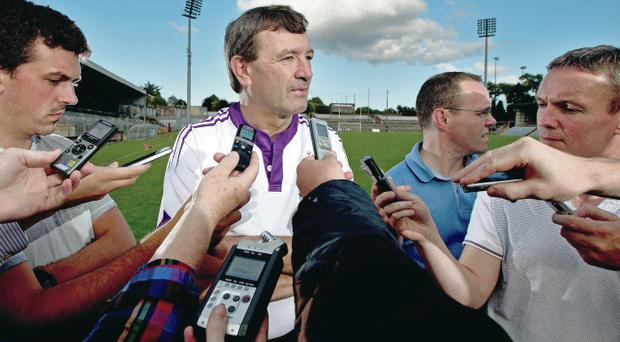 Serious job: Jimmy Barry-Murphy talks to the press in Cork