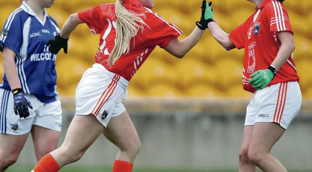 On target: Armagh's Lauren McConville celebrates with Mags McAlinden after scoring their third goal of the game