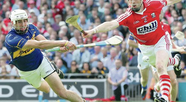 Full stretch: Cork's Shane O'Neill and Tipp's Patrick Maher battle