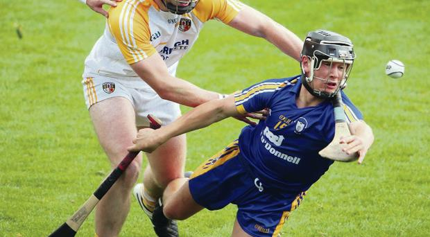 Sticking point: Antrim's Gearoid O'Connell wrestles with Ciaran Clarke of Clare at Thurles