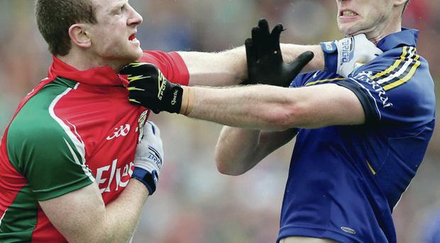 Squaring up: Kerry's Paul Geaney and Colm Boyle of Mayo get involved off the ball