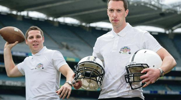 Different ball game: former Donegal footballer Kevin Cassidy (left) and ex-Dublin star Barry Cahill help promote the Croke Park Classic at the stadium yesterday