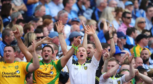Through thick and thin: Donegal fans roar their county to victory