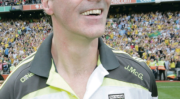 Smiles better: Jim McGuinness is delighted as Donegal reach the All-Ireland decider