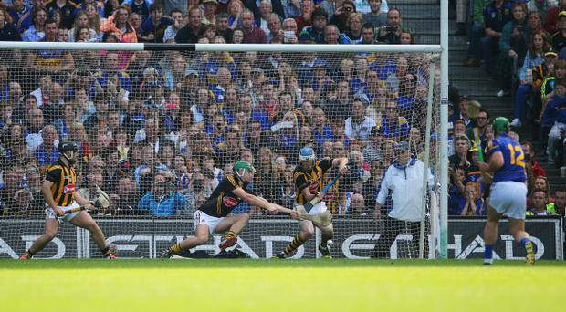 On the line: an official behind the goal keeps his eye on Sunday's All Ireland hurling final