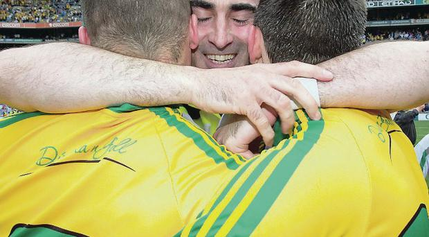 Brothers in arms: Jim McGuinness with Neil and Eamonn McGee after last month's stunning All-Ireland semi-final victory over Dublin