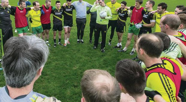 Everything covered: Donegal manager Jim McGuinness (with ball) addresses his panel before a training session