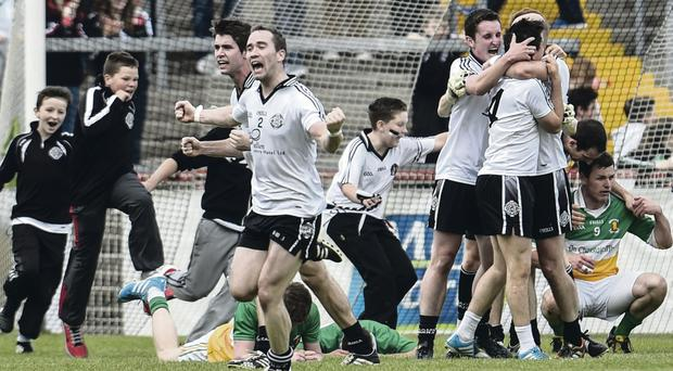 It's ours: Omagh captain, Hugh Gallagher, celebrates the win