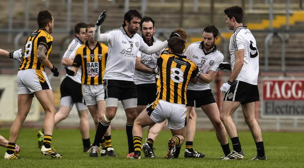 Hotly contested: Omagh St Enda's stars wrestle for possession with Crossmaglen Rangers' Johnny Hanratty