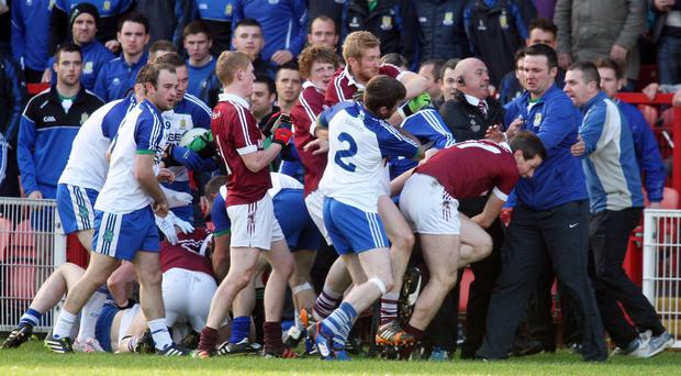 Ugly scenes: Ballinderry and Slaughtneil's players clash