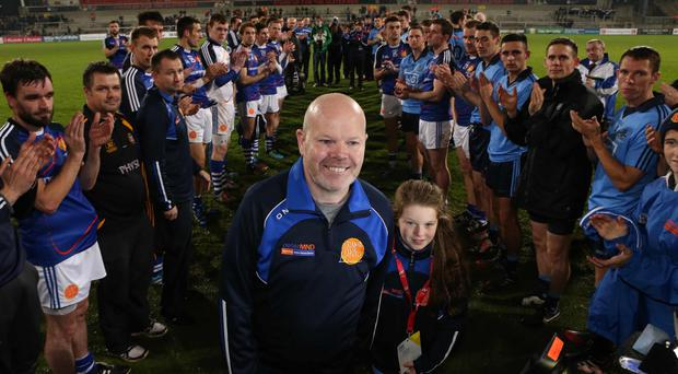 Teams' tribute: players line up to clap Anto Finnegan and his daughter Ava at the Game For Anto charity match at the Kingspan