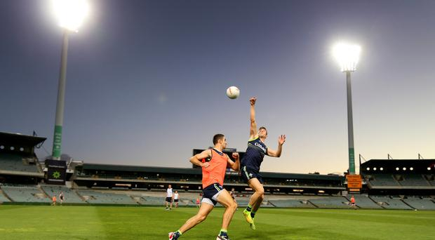 Hitting the heights: Ireland's James McCarthy and Colm Begley train in Perth yesterday ahead of the International Rules clash with Australia