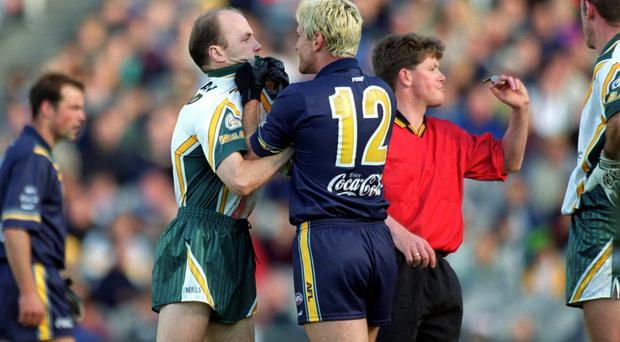 Getting shirty: Ireland's Peter Canavan and Australia ace Jason Akermanis get to grips with each other in 2000