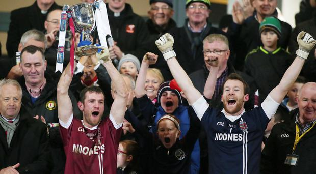 Glory day: Slaughtneil's captain Francis McEldowney lifts the trophy at the Athletic Grounds yesterday