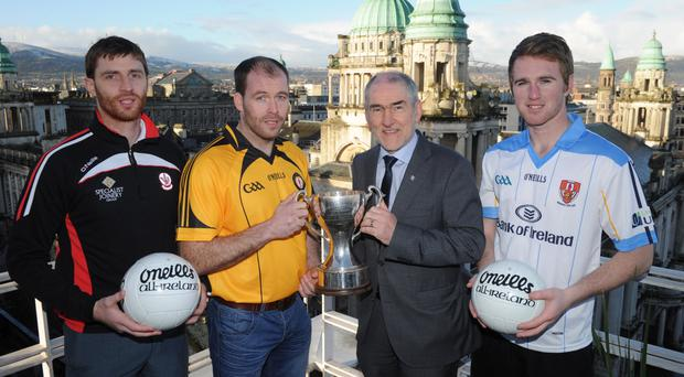 Bank on it: Pictured at the launch of the Bank of Ireland McKenna Cup are Tyrone boss Mickey Harte and players (from left) Gerard O'Kane (Derry), Ciaran McKeever (Armagh) and Paul Devlin (UUJ)
