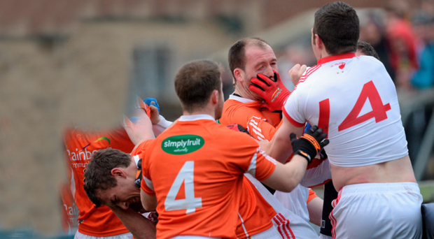 Tyrone and Armagh players clash during the earlier McKenna Cup meeting