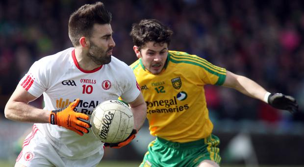 In hand: Tyrone's Tiernan McCann, pictured with Donegal ace Ryan McHugh, believes his side must persevere with current tactics