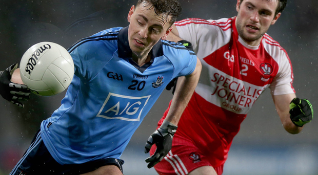 Eyes on the prize: Dublin's Cormac Costello peels away from Oisin Duffy of Derry last weekend as the Oak Leafs restrict their opponents to four points in 63 minutes