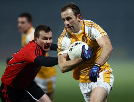 Making his point: Antrim's Michael Pollock was on target