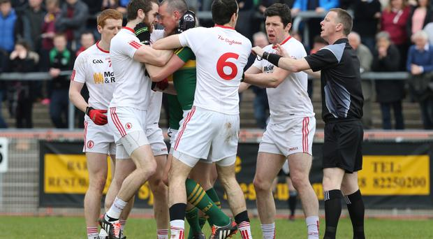 Head lock: Tyrone's Ronan McNamee and Kieran Donaghy of Kerry get to grips with each other during their National League meeting