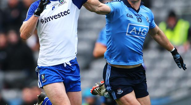 Man marked: Monaghan's Vinny Corey with Paul Flynn