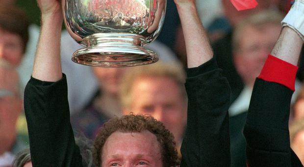Uplifting: DJ Kane collects the 1994 Ulster title for Down