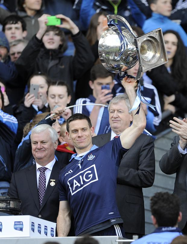 Champion: Dublin captain Stephen Cluxton lifts the cup