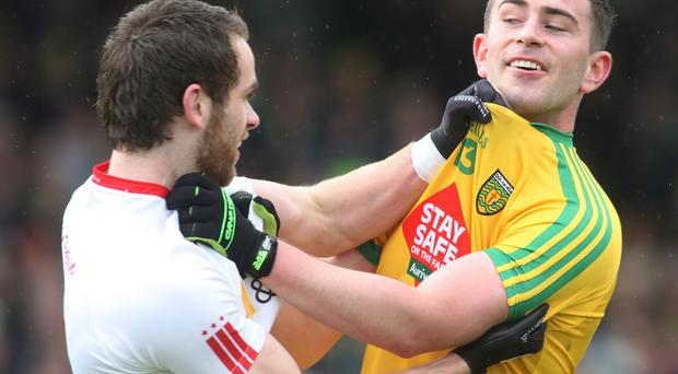 Donegal and Tyrone players square up