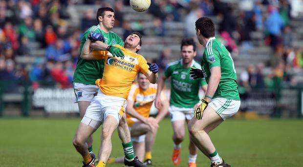 On a high: Fermanagh's Mickey Jones gets above Conor Murray