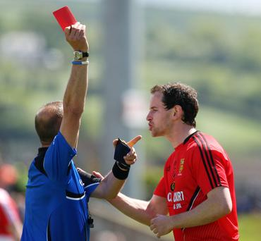 Red alert: Referee Eddie Kinsella sends off Down's Conaill McGovern